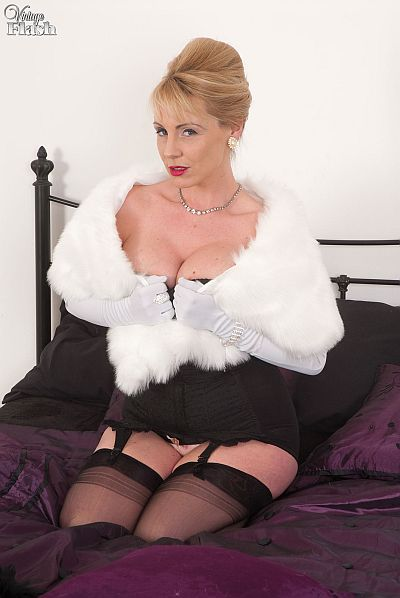 Clair Lou sexy glamour blonde in fur stole nylon stockings and suspenders masturbating video at vintageflash