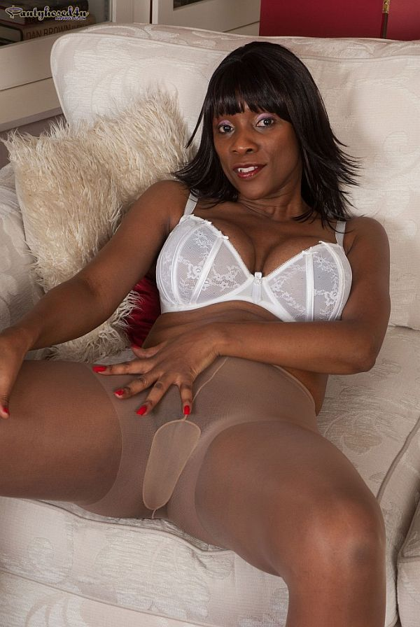 Ebony MILF With Big Boobs In White Bra Masturbating In Sheer Nylon Pantyhose