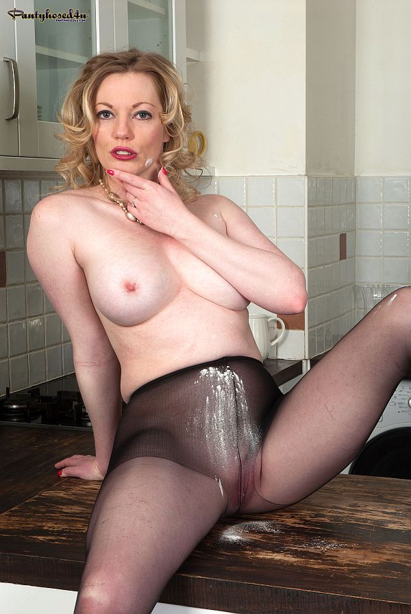 Sexy MILF With Naked Boobs Masturbating In The Kitchen In Black Sheer Nylon Pantyhose At Pantyhosed4u